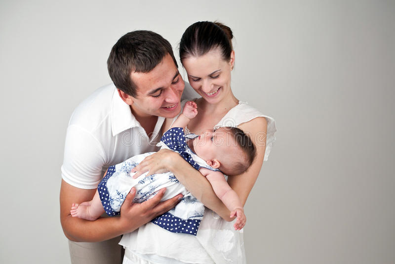 Careful parents. An image of happy parents with their child royalty free stock images