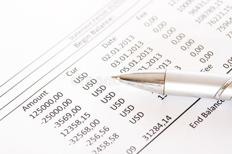 Check the monthly bank account statement. Carefully check the monthly bank account statement royalty free stock image