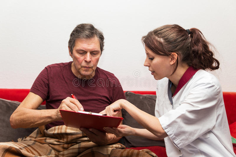 Caregiver with clipboard and patient. Caregiver with clipboard and senior adult royalty free stock images