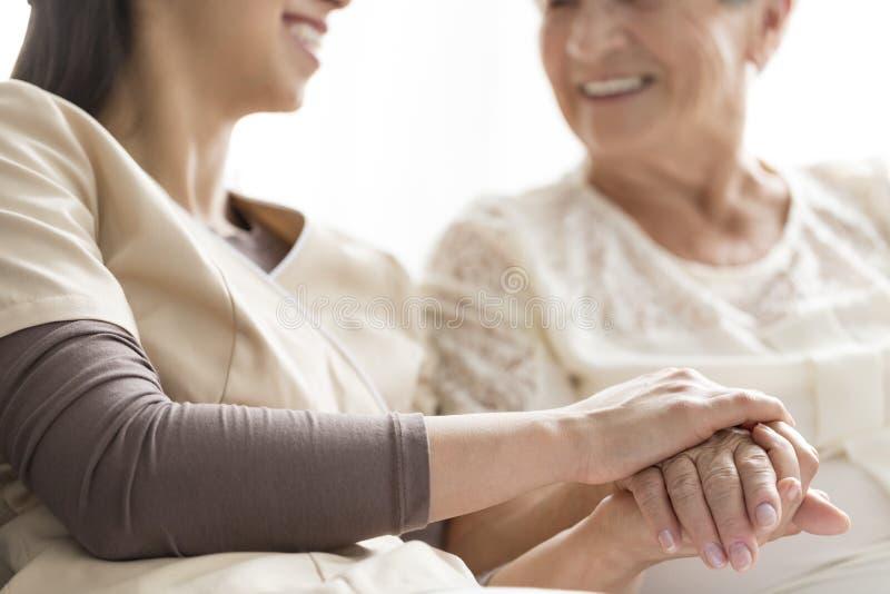 Caregiver in the nursing home stock photos