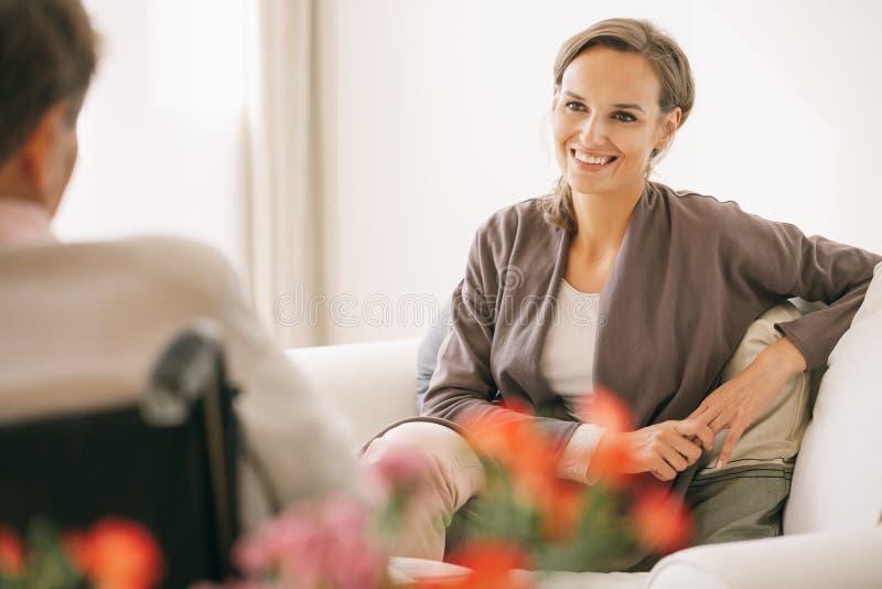 Caregiver in a nursing home stock photos