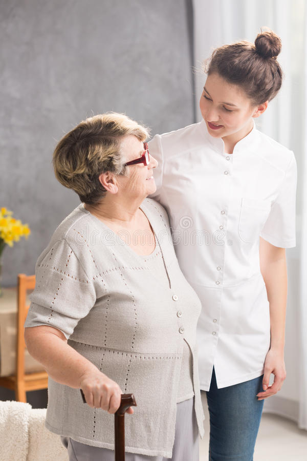 Caregiver and patient friendship. Caregiver and elderly women like spending time together royalty free stock photo