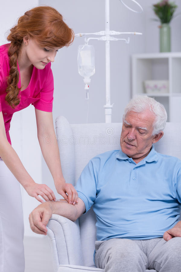 Caregiver and senior patient royalty free stock photo