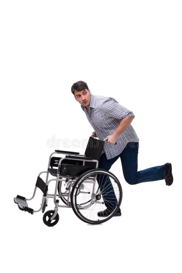 The caregiver with wheelchair isolated on white. Caregiver with wheelchair isolated on white stock photography