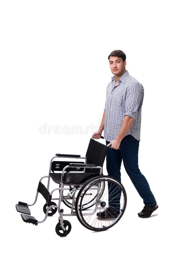The caregiver with wheelchair isolated on white. Caregiver with wheelchair isolated on white royalty free stock image