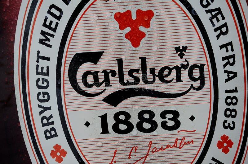 CARELBERG-ÖL I JÄNTA OCH KAN royaltyfri bild