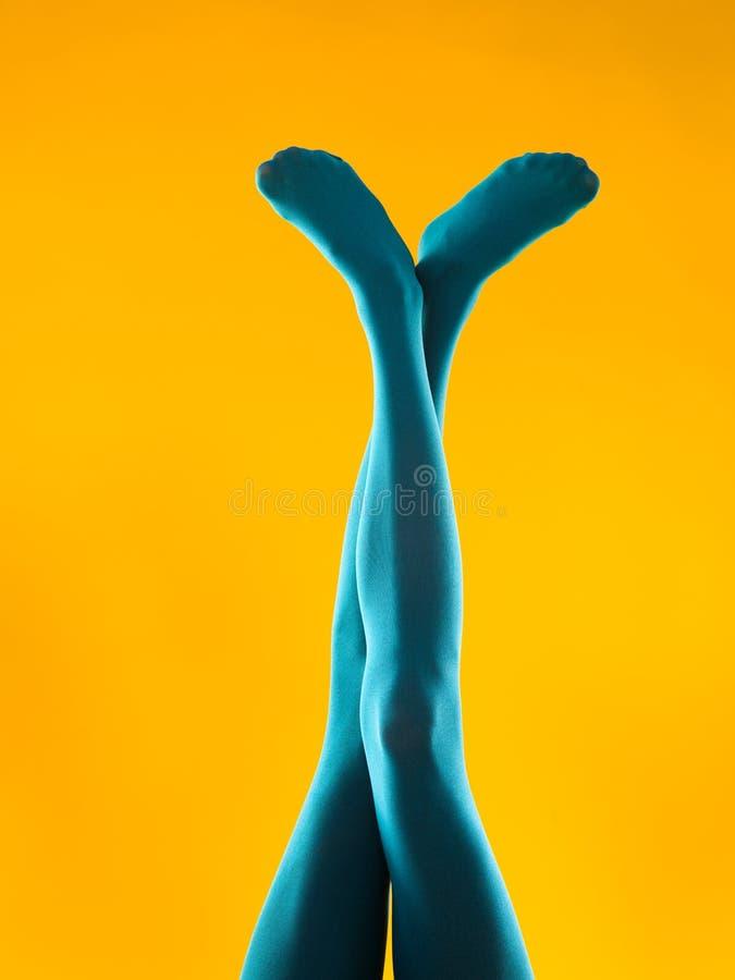 Careless legs in blue pantyhose