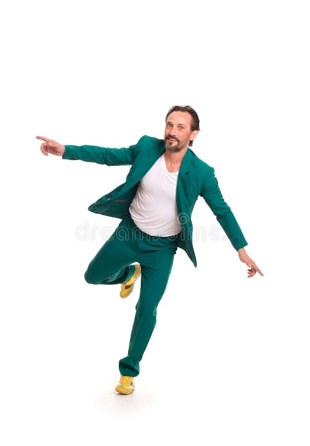 Handsome man in green suit. Careless man in nice green suit. Immitating flying stock photos