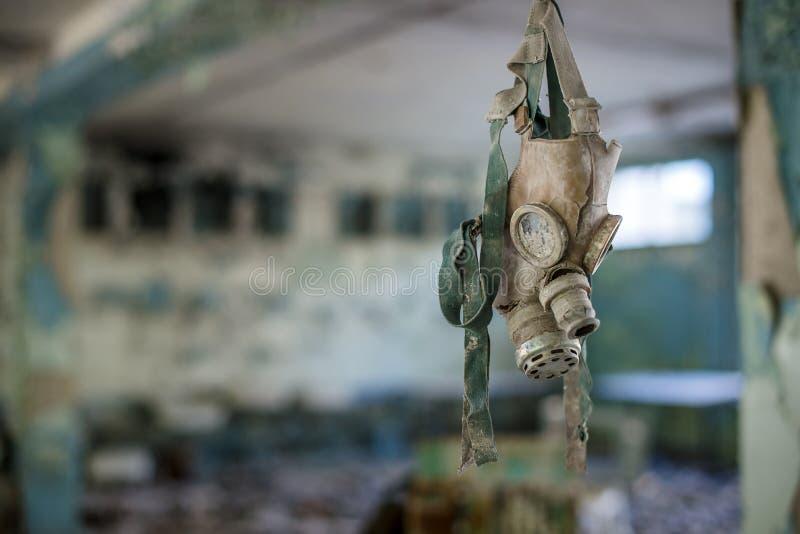 Caretas antigás en la escuela secundaria en Pripyat, zona de exclusión de Chernóbil Catástrofe nuclear fotos de archivo
