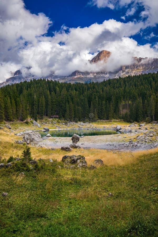 Carezza lake (Lago di Carezza, Karersee) with Mount Latemar, Bolzano province, South tyrol, Italy. royalty free stock photos