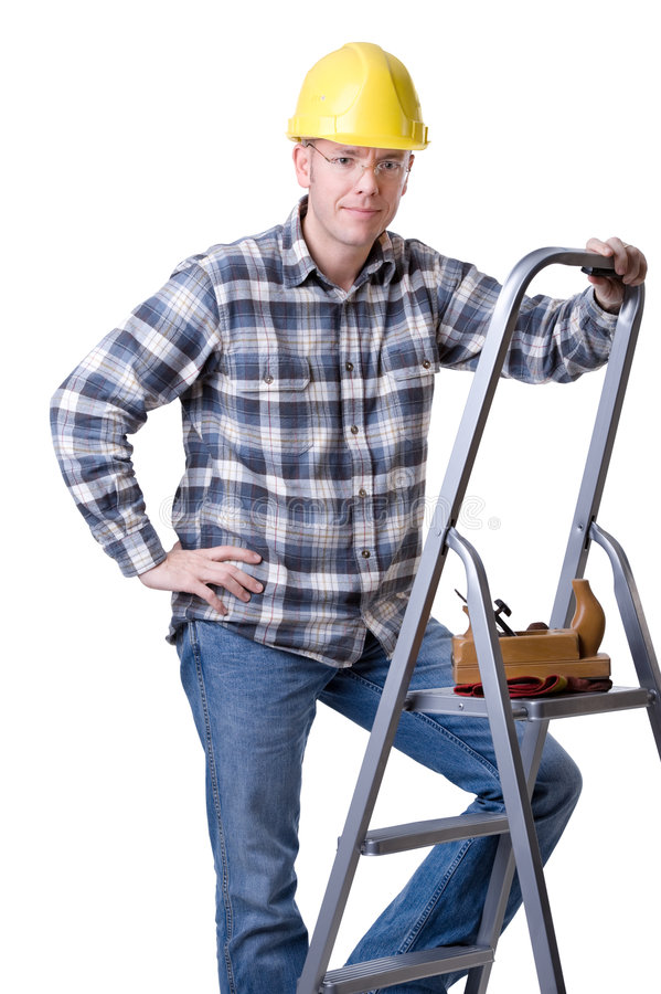 Carftsman on ladder. Full isolated studio picture from a young craftsman on a ladder stock photography