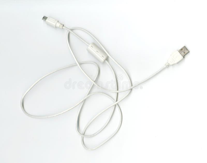 Carga por USB del alambre con un adaptador de tuberías fotografía de archivo