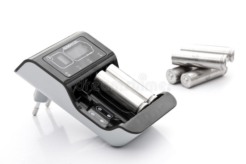 Cargador de batería con las baterías fotos de archivo libres de regalías