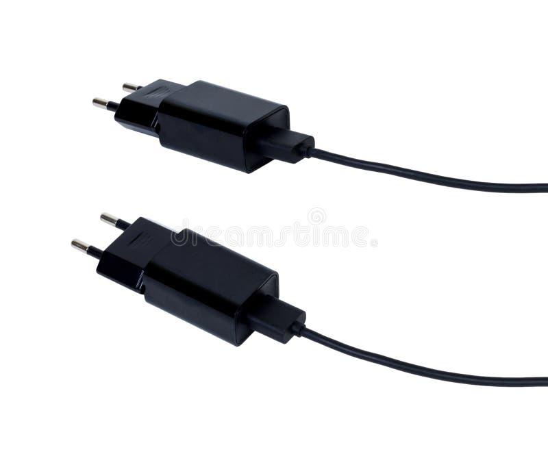 Cargador del adaptador con el aislante del cable del usb en la trayectoria de recortes blanca imagen de archivo libre de regalías
