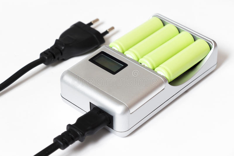 Cargador para cuatro baterías foto de archivo libre de regalías