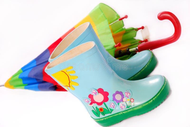 Cargadores del programa inicial y paraguas del `s Wellington de los niños foto de archivo libre de regalías