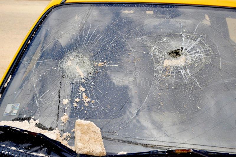 CARGLASS BREAKFAST CAR. Counterfeit glass of broken car because of its counterfeiting putting the users down must pay attention in their different choices stock photos
