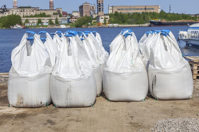Cargo in bags. Bagged cargo at the city pier stock photo