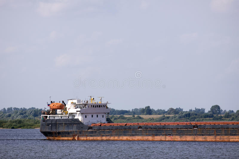 Cargo boat. Sailing in a river flow of northern europe royalty free stock image