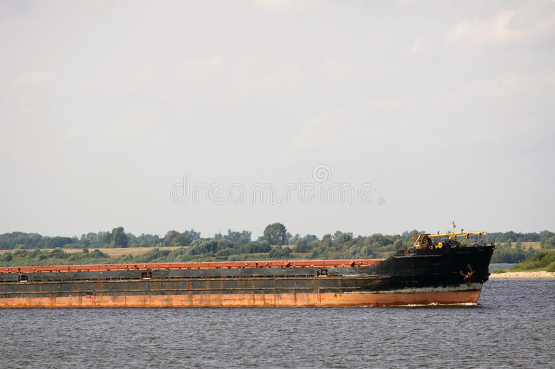 Cargo boat. Sailing in a river flow of northern europe stock image