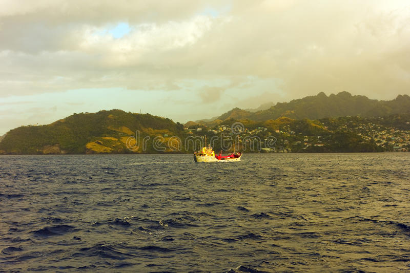 A cargo boat approaching st. vincent stock photos