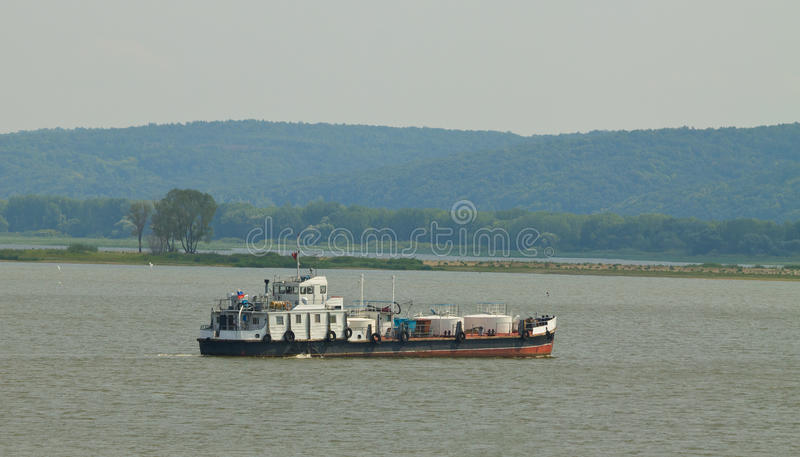 Cargo boat. The cargo boat on river Volga in Russia at summer. Shallow DOF royalty free stock images