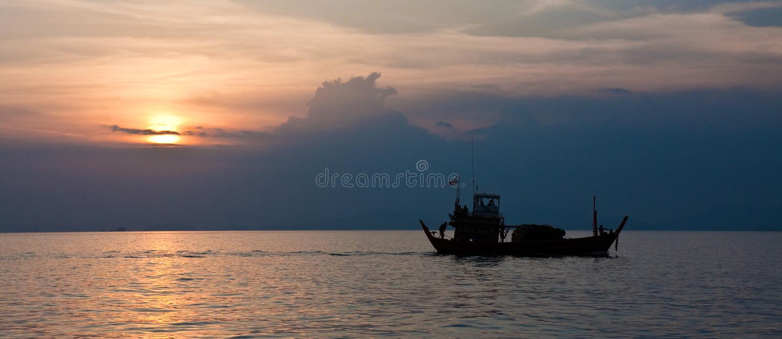 Cargo Boat at Sunset royalty free stock photos