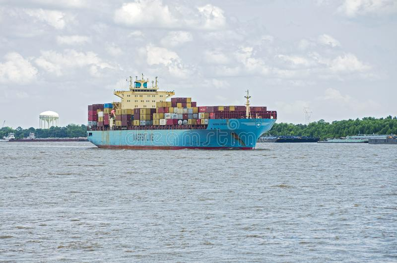 Cargo Carrier on Mississippi River Near New Orleans. New Orleans, Louisiana/USA - June 14, 2019: Maersk Line container ship navigating Mississippi River stock images