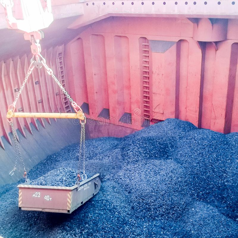The cargo compartment of the ship, filled with coal. Loading of stock images