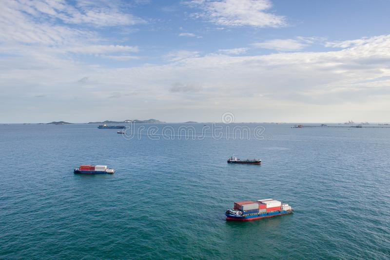 Cargo container ship loaded in channel headed out to sea. Cargo container ship loaded in channel headed out to sea stock photo