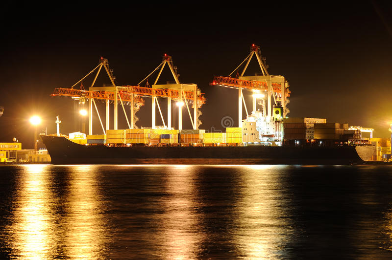 Cargo container ship at night stock image