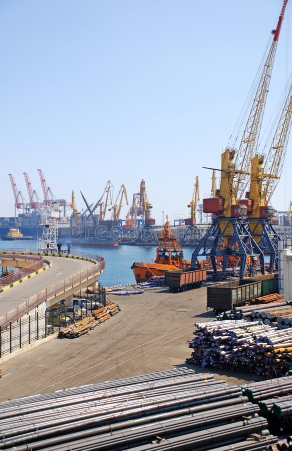 Cargo container ships and cranes at shipyard. royalty free stock images
