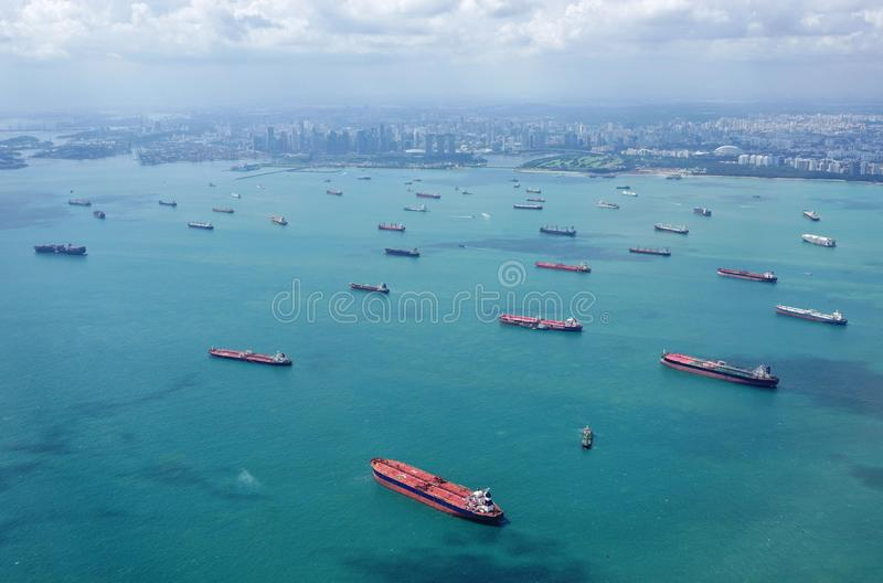 Cargo container ships lined up to enter the port of Singapore royalty free stock photos