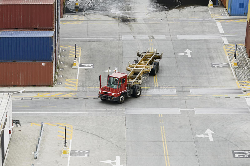 The cargo containers truck in storage area of freight port royalty free stock photo