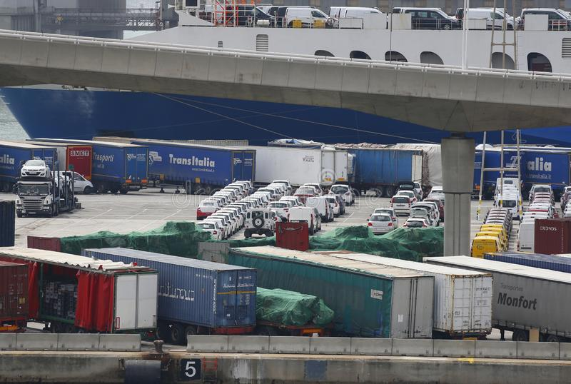 Cargo containers and vehicles in barcelona commercial port stock images