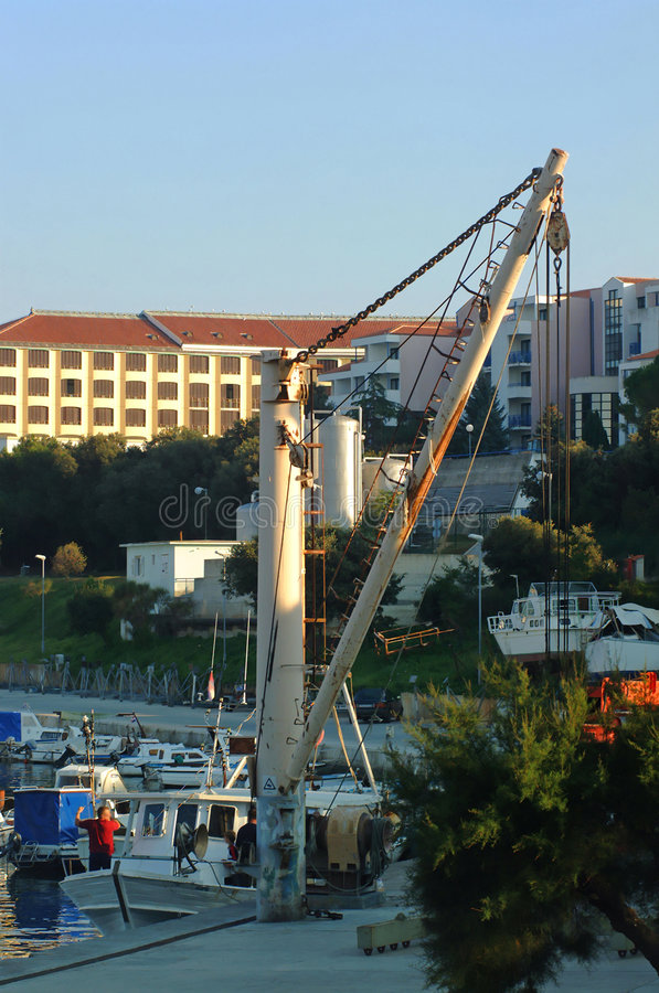 Cargo crane on marina dock stock photography