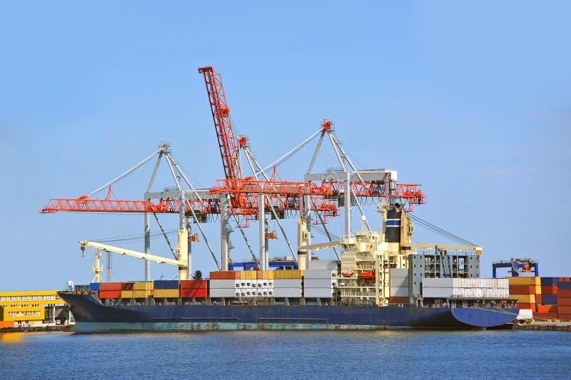 Cargo crane and ship. Container stack and ship under crane bridge royalty free stock photos