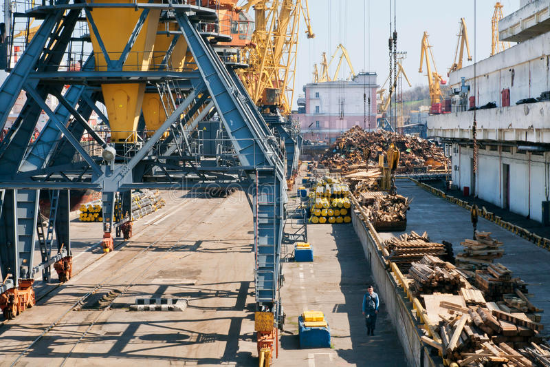 Cargo cranes on rails and cargo warehouses royalty free stock images