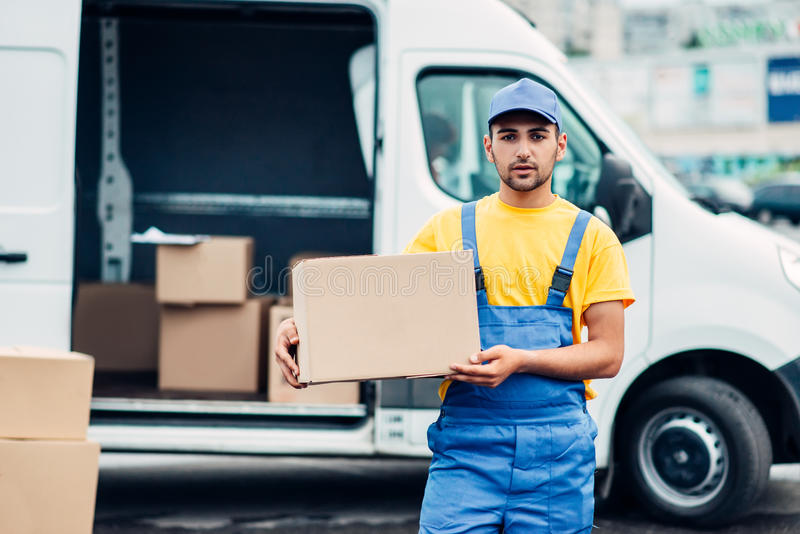 Cargo delivery service, male courier unload truck royalty free stock images