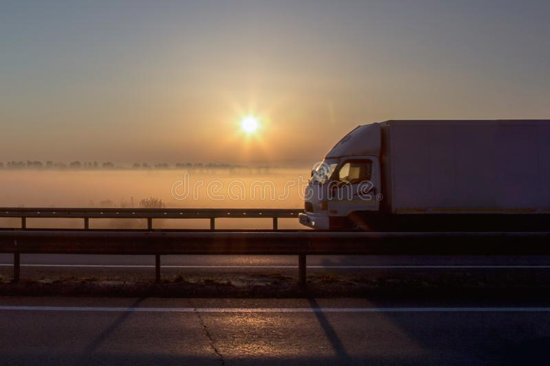 Cargo Delivery truck on sunset background, early morning stock photo