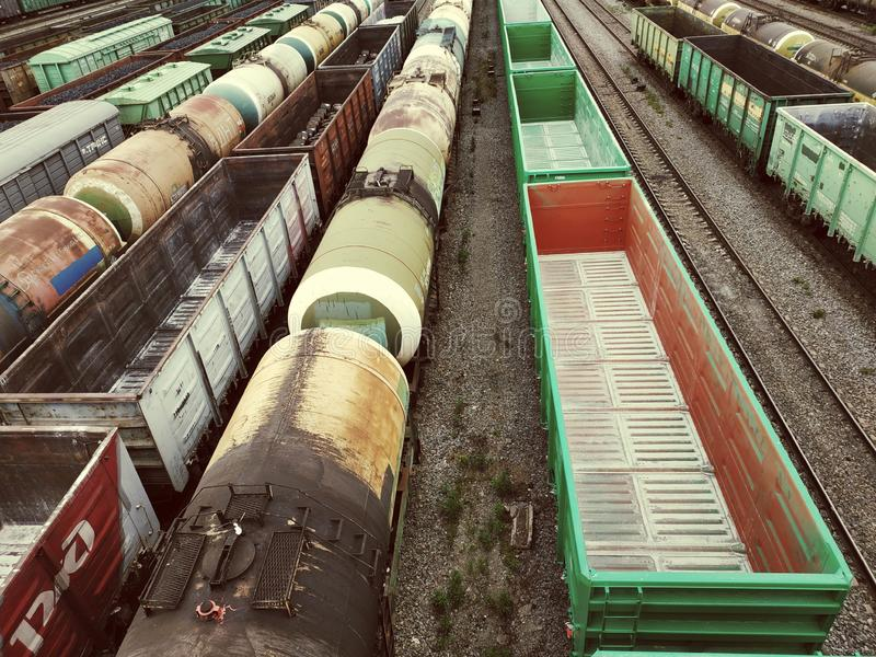 Cargo empty wagons. Cargo wagons on train station in city, aerial view stock photography
