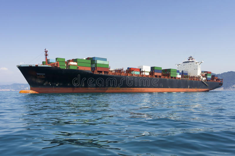 Cargo freight, container ship in sea royalty free stock photo