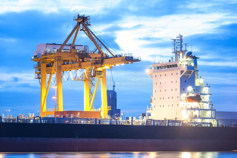 Cargo freight ship Industry and transportation concept. Industry and transportation concept, Container crane loading in a cargo freight ship with industrial stock image