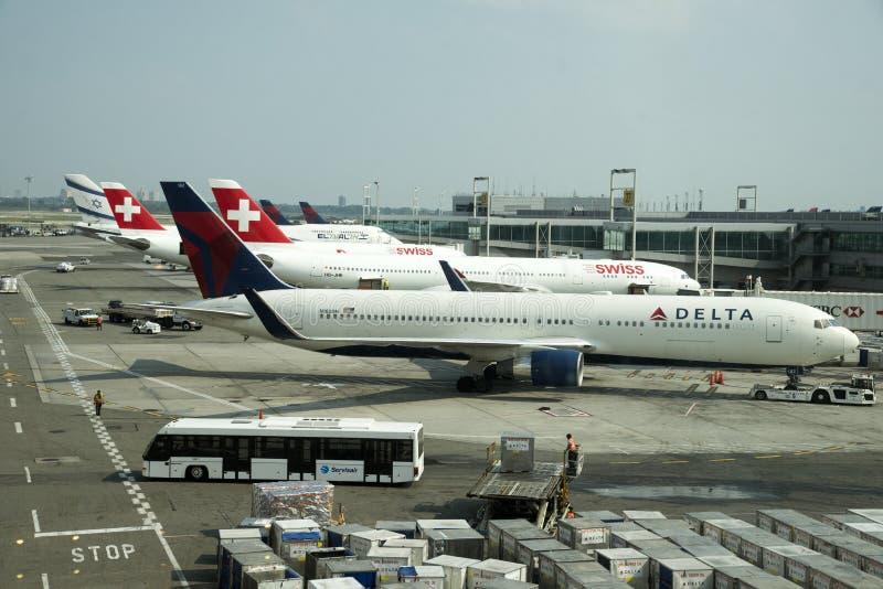 Cargo handling and passenger transport JFK NYC royalty free stock images
