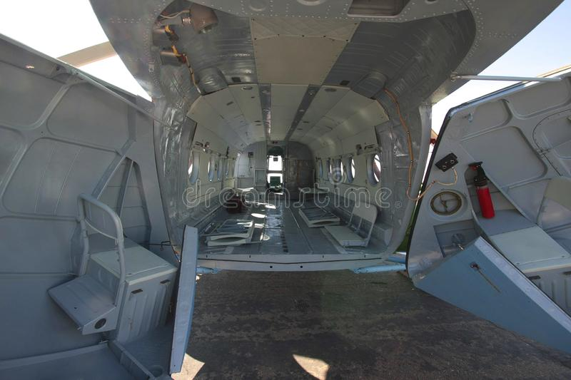 Cargo helicopter fuselage. Interior view of an empty cargo helicopter fuselage royalty free stock images