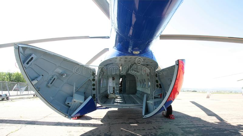 Cargo helicopter fuselage. Interior view of an empty cargo helicopter fuselage stock photography