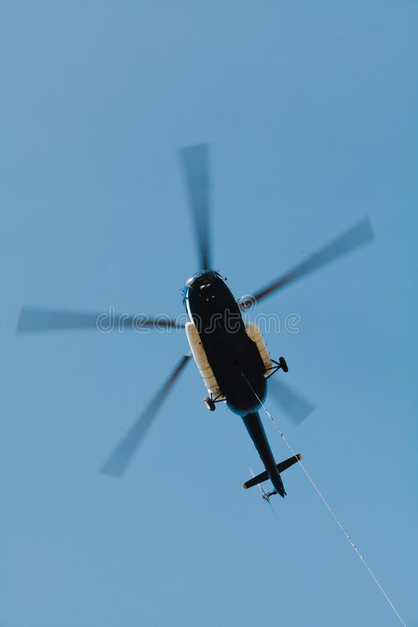 Cargo helicopter with suspended freight on cable - in action royalty free stock photos