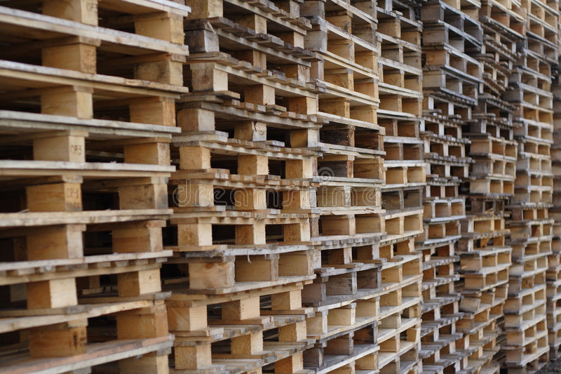 Cargo pallets. Stacks of used wooden cargo shipping pallets royalty free stock photography