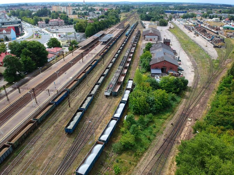 Cargo and passenger wagons on train station in city, aerial view. Cargo and passenger wagons on train station in city, aerial view stock photography