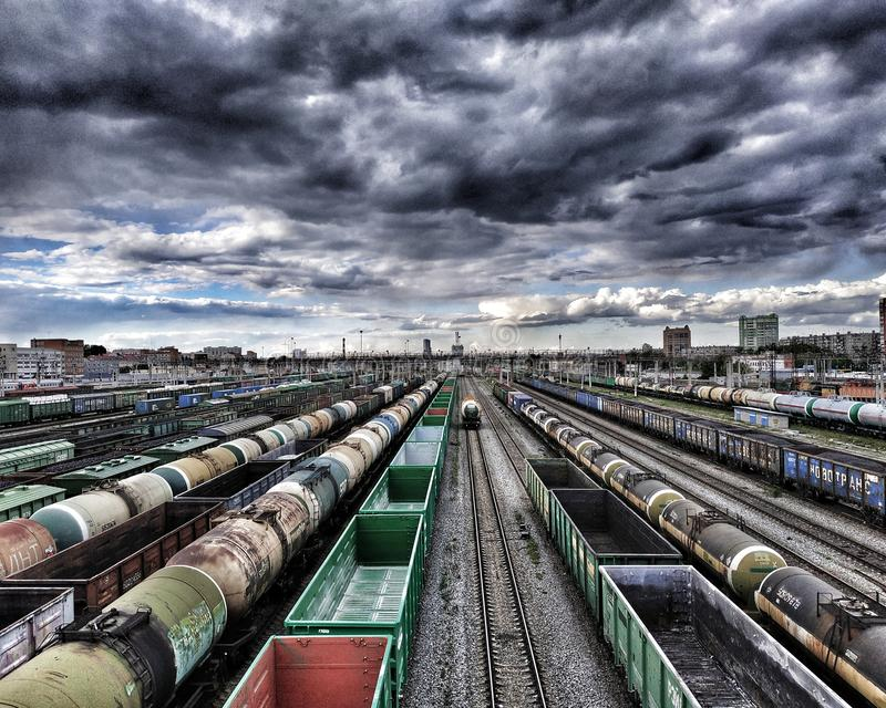 Cargo and passenger wagons. On train station in city; aerial view royalty free stock photography